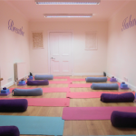 Peaceful studio room ready for a yoga class